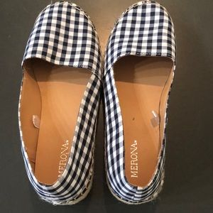 Worn once navy and white checkered shoes.